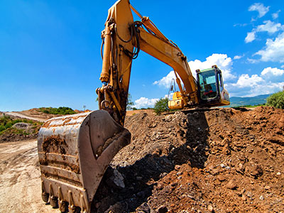 Yellow-excavator-moving-soil-and-sand-on-road-construction-site