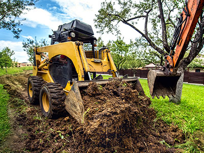 Yellow-mini-bulldozer-working-with-earth-moving-soil-and-doing-landscaping-work